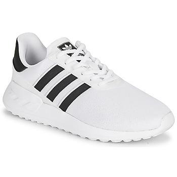 Sko Børn Lave sneakers adidas Originals LA TRAINER LITE J Hvid / Sort