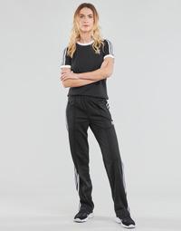 textil Dame Træningsbukser adidas Originals FIREBIRD TP PB Sort